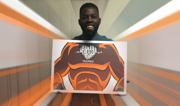 Basil Nyoni as a superhero supporting CPR training